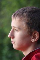Comment puis-je aider mon fils adolescent Survive Exclusion Clique & Gossip?